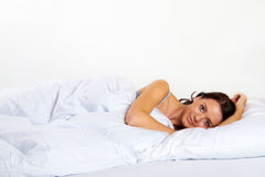 Happy woman in bed Stock Photos