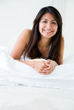 Happy woman in bed Stock Photo