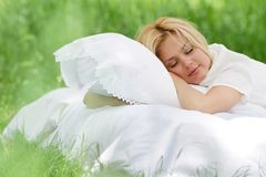 Happy woman on bed on natural background Stock Images
