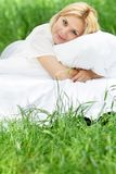Happy woman on bed on natural background Royalty Free Stock Images