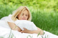 Happy woman on bed on natural background Stock Image