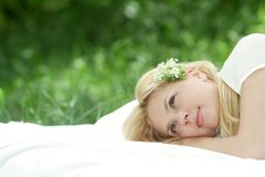 Happy woman on bed on natural background Stock Photography