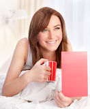 Happy woman in the bed Stock Image