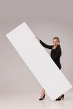 Happy woman behind blank copy space banner Royalty Free Stock Photography