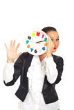 Happy woman behind clock show five fingers Royalty Free Stock Photo