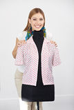 Happy woman behind dress form Stock Images