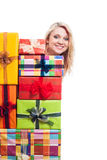 Happy woman behind many gifts Royalty Free Stock Photos