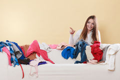 Happy woman behind sofa in messy room at home. Royalty Free Stock Images