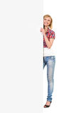 Happy woman behind a white banner Royalty Free Stock Photos