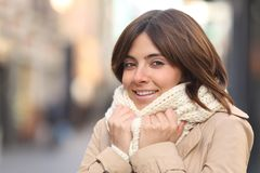 Happy woman being cold in winter in the street royalty free stock images