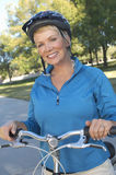 Happy Woman With Bicycle Royalty Free Stock Photos