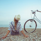 Happy woman with bicycle on the beach Stock Photography