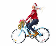 Happy woman on bicycle with christmas present. Stock Photo