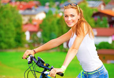 Happy woman on bicycle Stock Photos
