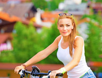 Happy woman on bicycle Royalty Free Stock Photos