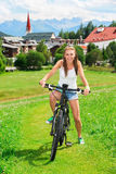 Happy woman on bicycle Royalty Free Stock Photo