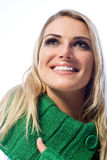 Happy woman with a big beaming smile. Low angle portrait of a happy woman with a big beaming toothy smile looking up thinking or daydreaming, on white Royalty Free Stock Photos