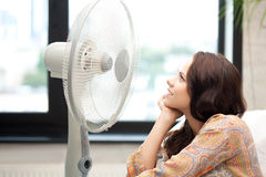 Happy woman with big fan Royalty Free Stock Photos