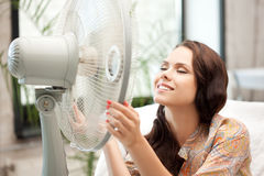 Happy woman with big fan Stock Images