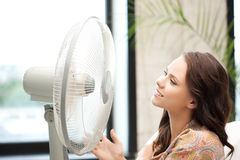 Happy woman with big fan Stock Photography