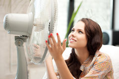 Happy woman with big fan Stock Image
