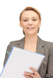 Happy woman with big notepad Stock Photos