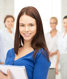 Happy woman with big notepad Stock Photography