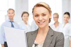 Happy woman with big notepad Stock Images