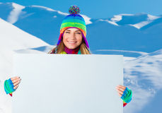 Happy woman with big postcard Royalty Free Stock Photography
