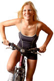 Happy woman on bike Stock Images