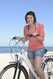Happy woman with bike on the beach Royalty Free Stock Image
