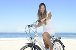 Happy woman with bike on the beach Royalty Free Stock Photography