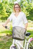 Happy Woman with the Bike Stock Images