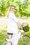 Happy Woman with the Bike Stock Photography