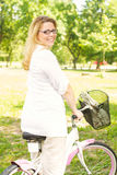 Happy Woman with the Bike Royalty Free Stock Photography