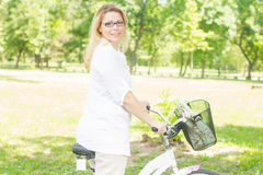 Happy Woman with the Bike Stock Image