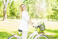 Happy Woman with the Bike Royalty Free Stock Image