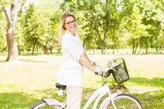 Happy Woman with the Bike Stock Photos