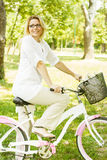Happy Woman with the Bike Royalty Free Stock Images