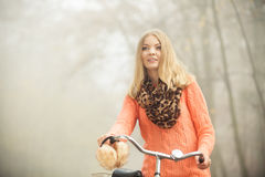 Happy woman with bike bicycle in autumn park. Royalty Free Stock Photos