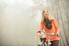 Happy woman with bike bicycle in autumn park. Stock Photography