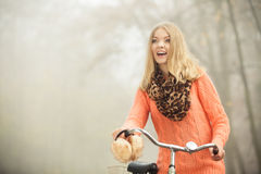 Happy woman with bike bicycle in autumn park. Royalty Free Stock Photography
