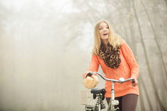Happy woman with bike bicycle in autumn park. Royalty Free Stock Photo