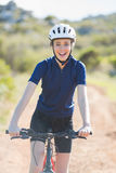 Happy woman with bike Royalty Free Stock Image
