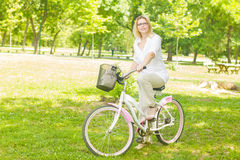 Happy Woman on the Bike Stock Images