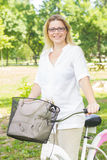 Happy Woman on the Bike Royalty Free Stock Photography