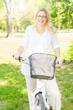 Happy Woman on the Bike Royalty Free Stock Photos