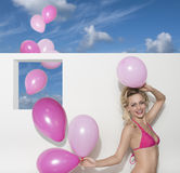 Happy woman with bikini and balloons Royalty Free Stock Photo