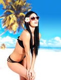 Happy woman in bikini on beach Stock Photo