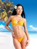 Happy woman in bikini on beach Stock Photos